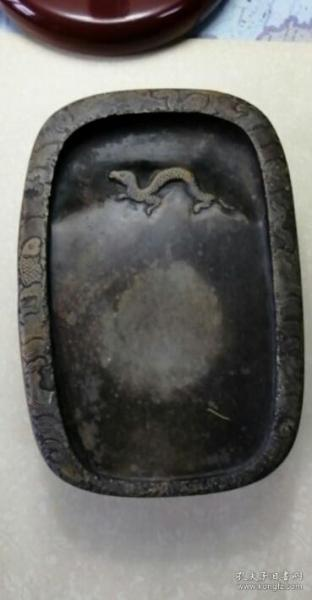 海水鱼化龙纹抄手石砚